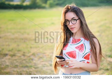 Portrait Of A Young Beautiful Woman In A Park At Sunset