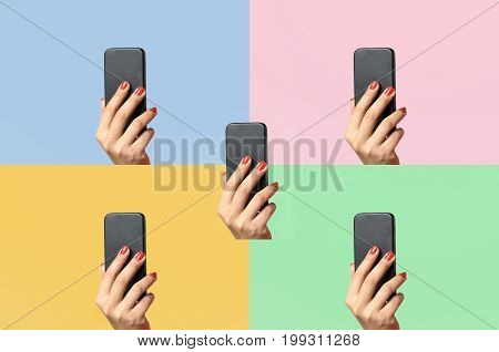 Woman Holding Up A Mobile Phone On Colors