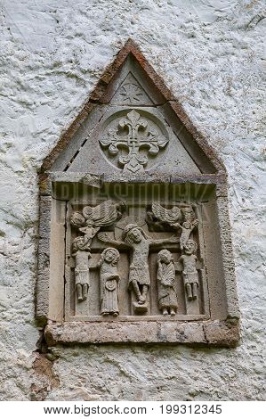 Bas relief on old lutheran church in Estonia