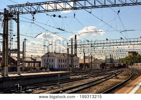 Moscow, Russia - August 11, 2017 - Urban Kursky train station. Railways and trains. One of largest central railway station of the city. Transport hub of Moscow. Platform, railway tracks, buildings.