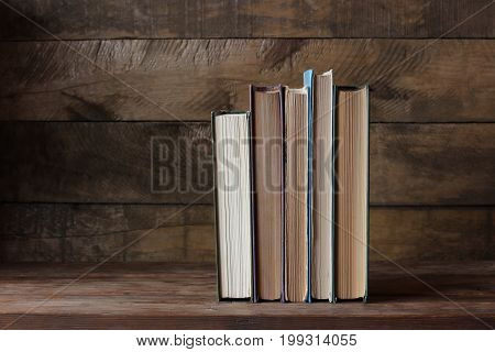 Old books on a wooden table. Empty space left for Your text.