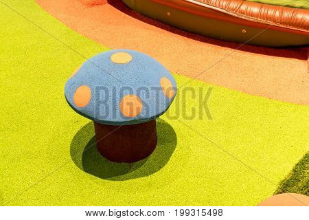 Artificial mushroom at Colourful Playground For Children. A children's playground equipment supplies / Safety rubber floor mats / outdoor recreations.