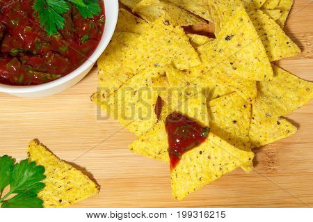 Nachos corn chips with classic tomato salsa. Nachos corn chips with classic tomato salsa.