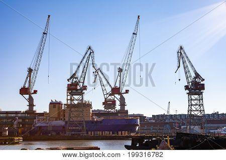 Harbor cranes in sea port of Helsinki, Finland. Sunny summer day