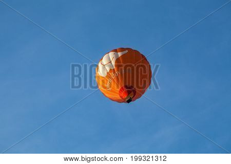 VILNIUS, LUTHUANIA - 22 AUG 2015: Red Hot Air Balloon in the air under city