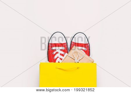 Big Red Gumshoes And Beautiful Gift In Cool Shopping Bag