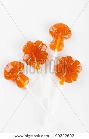 Orange Lollipops On White Background