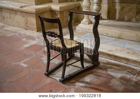 Chair with kneeling for devotees inside the church