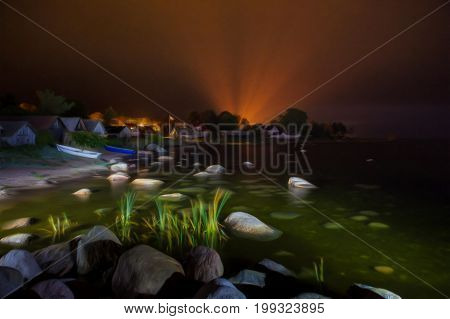 Small village Kasmu at night. Idyllic picture of sea with stoned coast and beautiful wooden houses. Digital painting over image