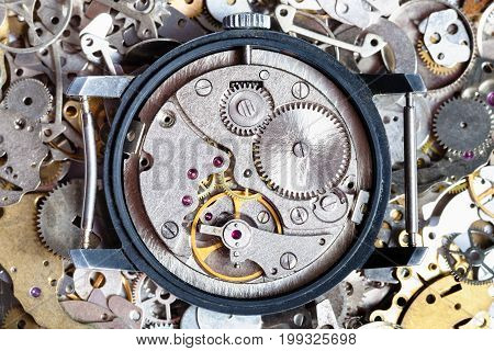 Open Vintage Watch On Heap Of Clock Spare Parts
