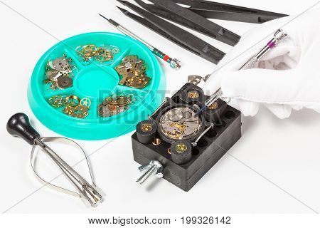 Repair Of Old Mechanic Wristwatch On White Table