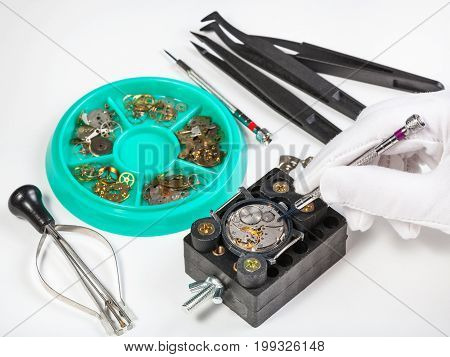 Repairing Old Mechanical Wristwatch On White Table