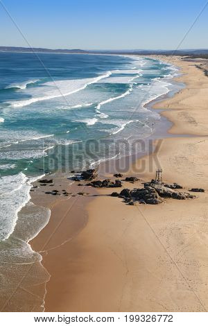 Aerial view of Redhead Beach just south of Newcastle- Australia. Newcastle a couple of hours north of Sydney is Australia's second oldest city and has many beautiful beaches such as this one stretching south towards Swansea Heads.