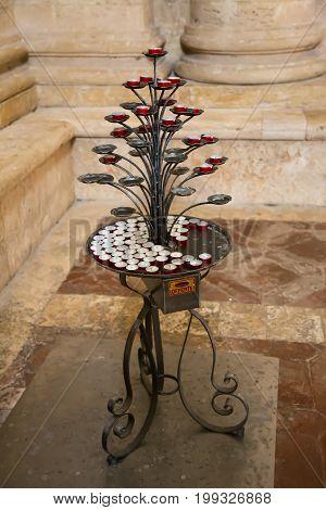 Circular votive candles on a particular candlestick