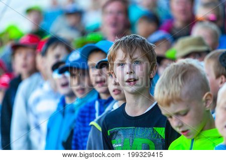 Tallinn, Estonia - July 05, 2014: Big children choir singing estonian songs
