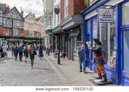 CANTERBURY ENGLAND - JUNE 07 2017: Shopping street with people downtown old historic Canterbury city Kent England