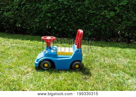 vintage bobby car in meadow play toy kids classic fun