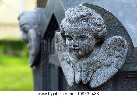 Sculptural image of an angel carved on a granite slab of a coffin