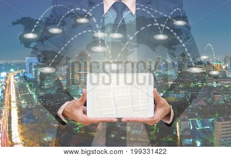 Businessman showing part of navigator map over the tablet screen on connection line over the world map with cityscape Navigation concept,3D illustration