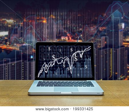 Stock exchange market trading graph over the screen of computer laptop on wood table over the photo blurred of trading graph background business marketing trade concept