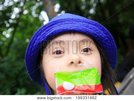 Funny little girl with a snack .