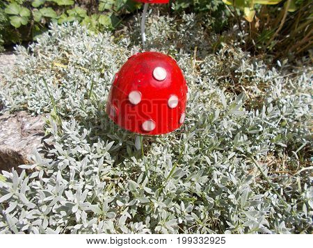 Ornamental Toadstool in a garden among the plants.