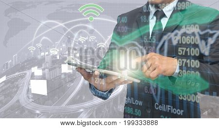 Double exposure of businessman using the tablet with Stock market chart on Network connection line between building over the top view of cityscape background Business Trading and connection concept,3D illustration