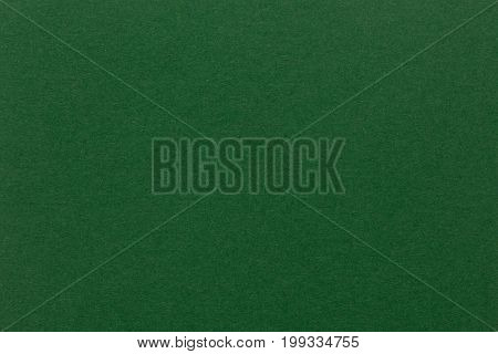 Blank piece of green paper as background. Close-up. High quality texture in extremely high resolution