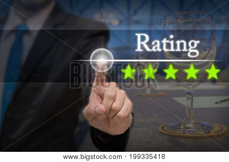 Businessman pointing five star button to increase rating of hotel over workplace with Glass of water paper and pencil on the table in the hall room business evaluation concept Increase rating,3D illustration
