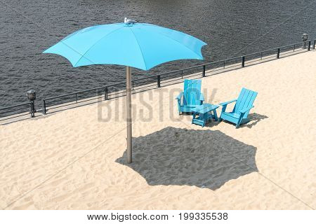 Clock Tower Beach Old Port In Montreal Canada Two Blue Chairs With Parasol