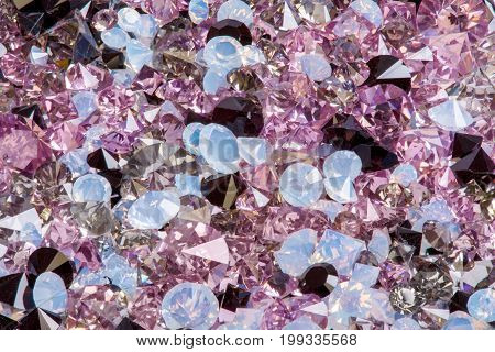 Many small diamond jewel stones, luxury background close-up. Hi res photo.