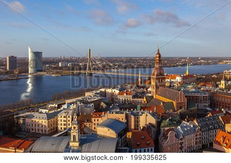 RIGA, LATVIA - 25 DEC 2015. Aerial panoramic view of old town, Daugava river and modern skyscrapers o Riga. Clear sunny day.