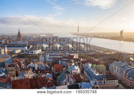 RIGA, LATVIA - 25 DEC 2016. View of old town, Daugava River and Riga TV and radio tower - Latvia. Sunny summer day, backlight
