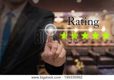 Businessman pointing five star button to increase rating of hotel over Abstract blurred photo of conference hall or seminar room with attendee background business evaluation concept Increase rating,3D illustration