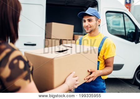 Cargo delivery, courier gives parcel to the client