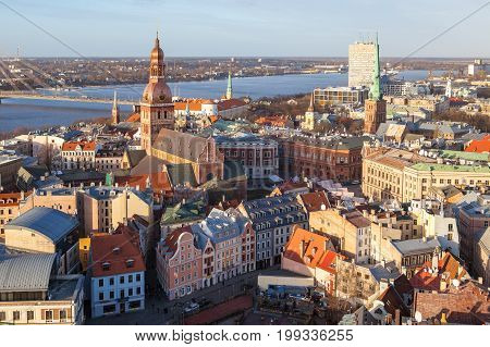 RIGA, LATVIA - 25 DEC 2015. Aerial panoramic view of old town, Daugava river and modern bridge over river. Clear sunny day.