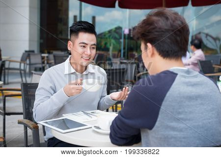 Two businessman having a casual meeting or discussion in the city.