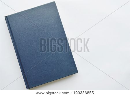 blue hard cover book on white background