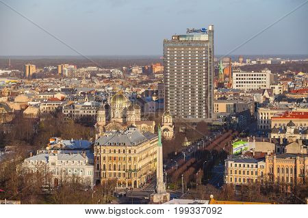 RIGA, LATVIA - 25 DEC 2015. City aerial view. Monument of freedom, Nativity of Christ Orthodox Cathedral and Radisson hotel