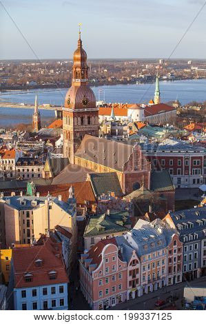 Riga Cathedral, Daugava river beautuful old town buildings, aerial summer day view of old town from St Peter church, Latvia. Vertical shot