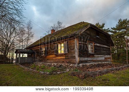 View of the rustic farm dwelling - stoned and wooden. Wooden architecture of North and Baltics
