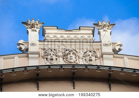 An element of facade of an Art Nouveau building with bas-relief and statues. Riga, Latvia. poster