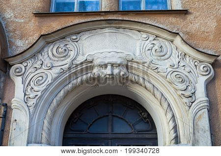 An element of facade of an Art Nouveau building with bas-relief and statues. Riga, Latvia.