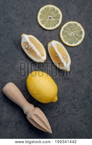Fresh Lemons And  Lemons Leaves On Dark Stone Background. Fresh Lemons And Lemon Slice On Dark Stone