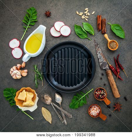 Italian Food Cooking Ingredients On Dark Stone Background With Iron Pan Flat Lay And Copy Space.
