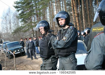 Khimki, Moscow region, Russia - April 23, 2011. Russian police on the protest of environmentalists in the Khimki forest. Defenders of the Khimki forest opposes the felling of trees.