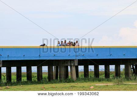 PHATTHALUNG,Thailand : August 12, 2017 : Tourists taking pictures on Chaloem Phra Kiat 80 Phansa bridge