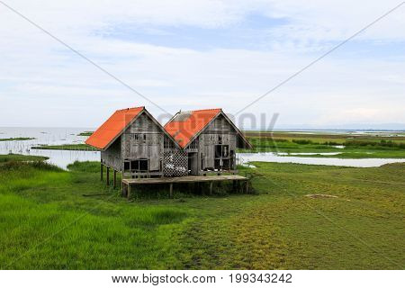 Twin house is abandons on wetland at Talay Noi lake at Phatthalung,southern of Thailand.