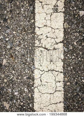 white lines on an asphalt road-narrow depth of field