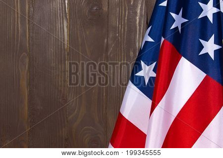 American flag on a background of brown wood .The Flag Of The United States Of America. The place to advertise template.